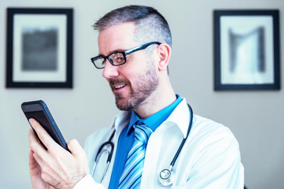 male-medical-service-provider-doctor-nurse-practitioner-using-a-smart-phone-to-video-chat-conference_t20_PQJ3Rr